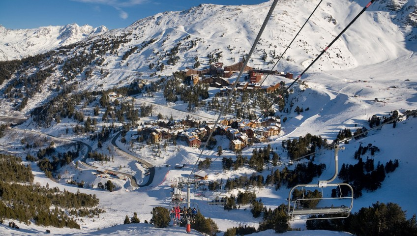 View from a ski lift overlooking a ski resort