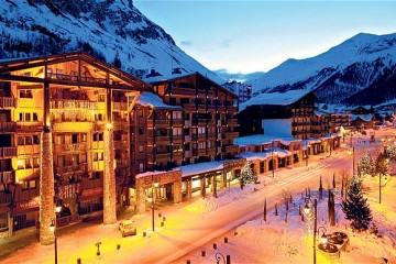 Night time view of Val dIsere ski resort street and buildings