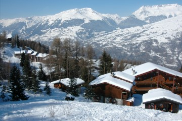 Ski chalets on the mountainside covered in snow