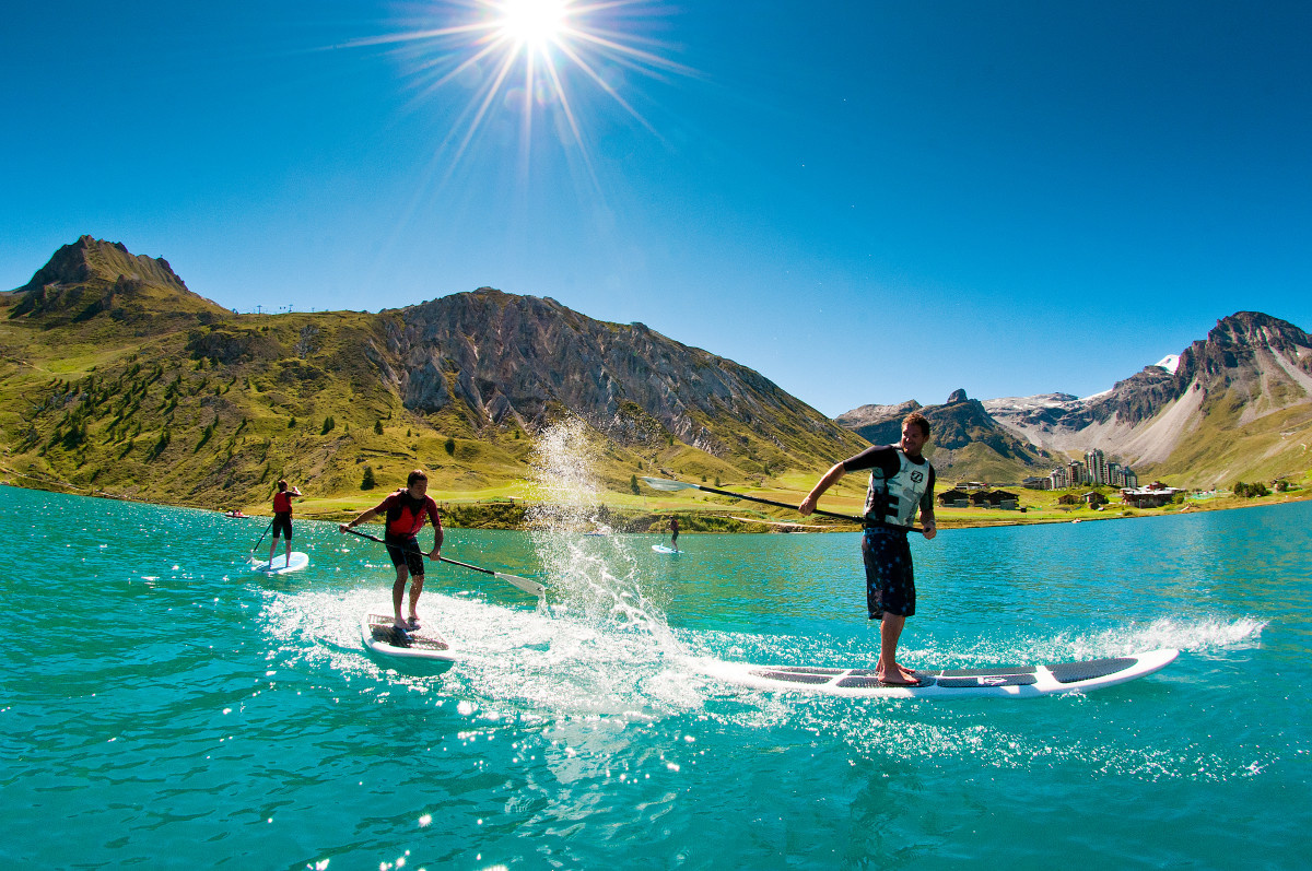 Stand up paddle boarders on Tignes Lake