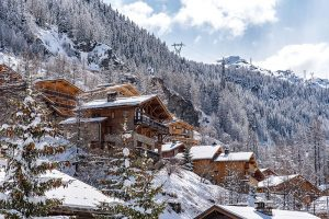 Ski chalets set on snowy hillside