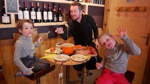 family eating fondu